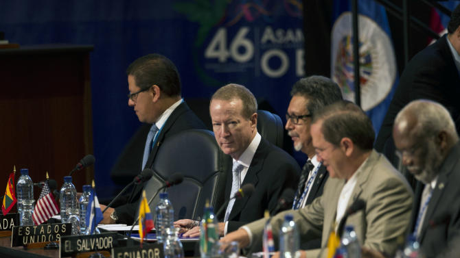 U.S. Assistant Secretary for the Bureau of International Narcotics and Law Enforcement Affairs, William Brownfield, second from left, attends the inauguration of the Organization of American States (OAS) 46th Special General Assembly in Guatemala City, Friday, Sept. 19, 2014. (AP Photo/Moises Castillo)