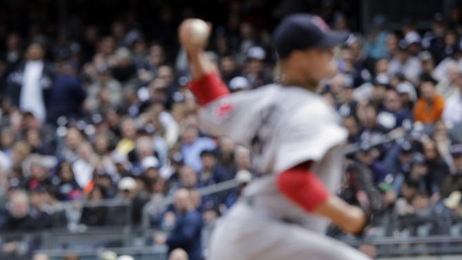 New York Yankees' Ichiro Suzuki, bottom, of Japan, watches from first base as Boston Red Sox's Jon Lester pitches during the second inning of an opening day baseball game, Monday, April 1, 2013, in New York. (AP Photo/Matt Slocum)
