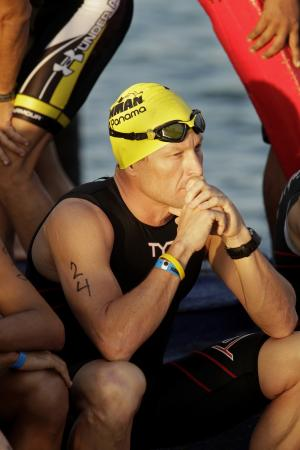 """FILE - In this Feb. 12, 2012, file photo, Lance Armstrong waits for the start of the Ironman Panama 70.3. triathlon in Panama City, Panama. The U.S. Anti-Doping Agency is bringing doping charges against the seven-time Tour de France winner, questioning how he achieved those famous cycling victories.  Armstrong, who retired from cycling last year, could face a lifetime ban from the sport if he is found to have used performance-enhancing drugs. He maintained his innocence, saying: """"I have never doped."""" (AP Photo/Arnulfo Franco, File)"""