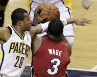 Indiana Pacers guard Leandro Barbosa, left, fouls Miami Heat guard Dwyane Wade during the second half of Game 3 of their NBA basketball Eastern Conference semifinal playoff series in Indianapolis, Thursday, May 17, 2012. The Pacers won 94-75. (AP Photo/Michael Conroy)