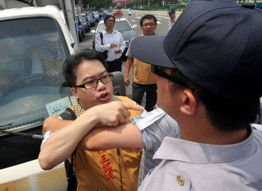 Anti-China activists in Taiwan quarrel with police during a protest against an investment pact with China