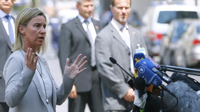 European Union foreign policy chief Mogherini talks to journalists outside the venue for nuclear talks in Vienna