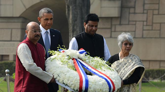 U.S. President Barack Obama arrives to offer floral tributes at the site where Indian independence icon Mahatma Gandhi was cremated in New Delhi, India, Sunday, Jan. 25, 2015. Obama's arrival Sunday morning in the bustling capital of New Delhi marked the first time an American leader has visited India twice during his presidency. Obama is also the first to be invited to attend India's Republic Day festivities, which commence Monday and mark the anniversary of the enactment of the country's democratic constitution. (AP Photo)