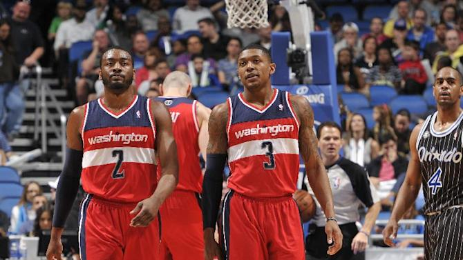 Wall helps Wizards down Magic 105-101 in overtime