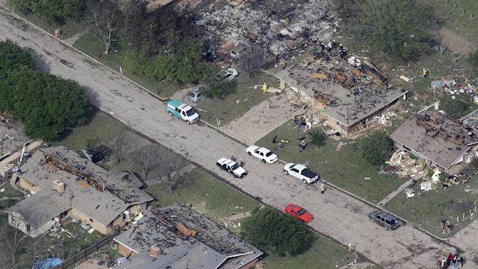 In this Thursday, April 18, 2013 photo, emergency personnel investigate the scene of several homes destroyed by an explosion at the West Fertilzer Co. in West, Texas. Rescuers searched the smoking remnants for survivors of Wednesday night's thunderous fertilizer plant explosion, gingerly checking smashed houses and apartments for anyone still trapped in debris while the community awaited word on the number of dead. Initial reports put the fatalities as high as 15, but later in the day, authorities backed away from any estimate and refused to elaborate. More than 160 people were hurt.  (AP Photo/Tony Gutierrez)