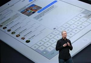 Apple Inc CEO Tim Cook speaks on stage about the new iPad during an Apple event in San Francisco