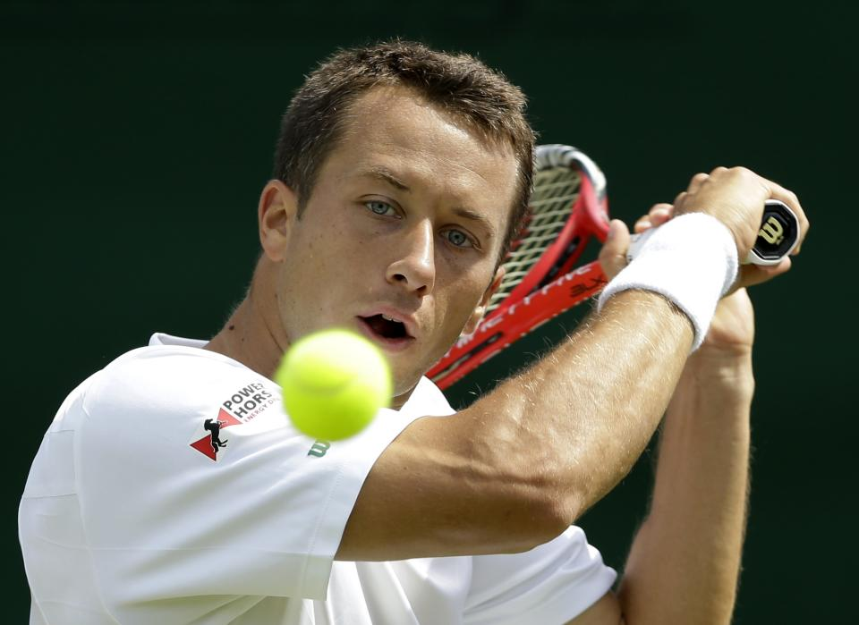 Philipp Kohlschreiber of Germany returns a shot against Lukas Rosol of the Czech Republic during a third round men's singles match at the All England Lawn Tennis Championships at Wimbledon, England, Saturday, June 30, 2012. (AP Photo/Kirsty Wigglesworth)