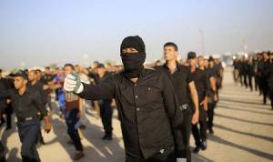 Mehdi Army fighters march during a military-style training in the holy city of Najaf