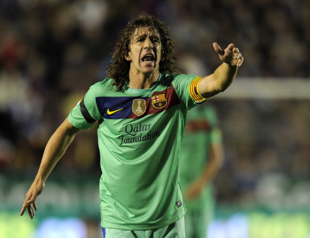 FC Barcelona's Captain Carles Puyol Gestures AFP/Getty Images