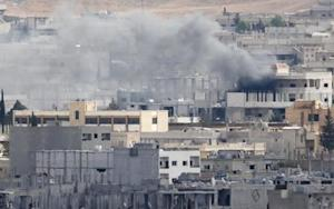 Smoke rises over Syrian town of Kobani, as seen from…
