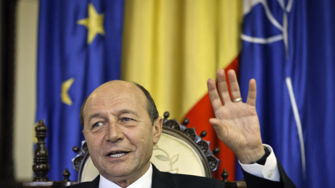 Romanian President Traian Basescu speaks during an interview with the Associated Press in Bucharest, Romania,  Thursday, March 7, 2013.  Romania's president says that the country should do more to tackle corruption if it wants to join the European Union's open border area, known as the Schengen Area. Basescu said that joining the so-called Schengen Area should become a national priority for the country of 19 million which joined the European Union in 2007. The Schengen Area is named after the town in Luxembourg where the open border agreement was signed.(AP Photo/Vadim Ghirda)
