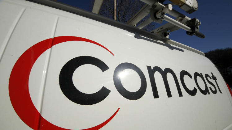 "FILE - This Feb. 11, 2011 file photo shows the logo on a Comcast truck in Pittsburgh.    Comcast reported on Wednesday Aug. 1, 2012 strong second-quarter earnings  from cable operations which overcame returns of the box-office flop ""Battleship.""   (AP Photo/Gene J. Puskar, file)"