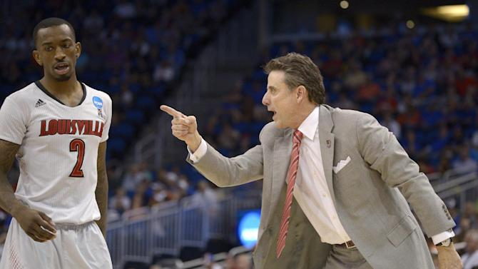 Louisville coach Rick Pitino, right, yells at guard Russ Smith (2) during the second half in a third-round game in the NCAA college basketball tournament against Saint Louis,  Saturday, March 22, 2014, in Orlando, Fla