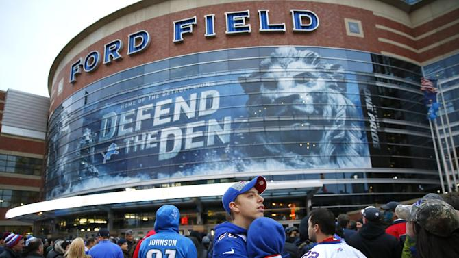 Nick May and Ashley Gangi of Buffalo, New York wait outside Ford Field before an NFL football game against the New York Jets in Detroit, Monday, Nov.24, 2014.The Bills had to move their game against the Jets to Detroit, where it will be played Monday night, because of the heavy snow that hit the Buffalo area