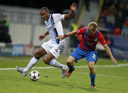 Manchester City's Kompany challenges Viktoria Plzen's Kolar during their Champions League group D soccer match at the Doosan Arena in Prague, Czech Republic