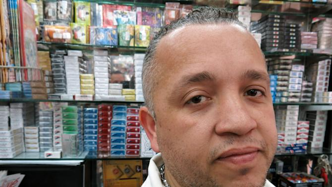 "Inacio Pinheiro poses for a photo as he works at his newspaper stand in Sao Paulo, Brazil, Friday, June 21, 2013. The 41-year-old vendor says ""The government is to blame for this mess because of the corruption and taxes. Dilma's response hasn't been appropriate at all_where is she?"" (AP Photo/Bradley Brooks)"