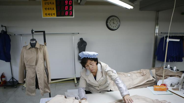 North Korean employee works in a factory of a South Korean company at the Joint Industrial Park in Kaesong industrial zone