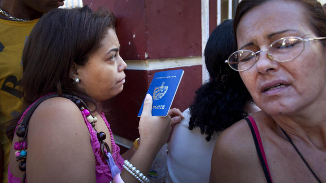 Lines at Cuba travel agencies on day 1 of new law