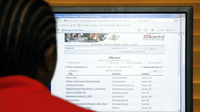 Corey Perry of Jackson, reviews possible jobs online at a state employment center in Jackson, Miss., Thursday, July 7, 2011. Unemployment rises to 9.2 pct. in June, as employers add only 18,000 jobs. (AP Photo/Rogelio V. Solis)
