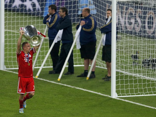 Bayern Munich's Franck Ribery celebrates with the trophy after defeating Borussia Dortmund in their Champions League Final soccer match at Wembley Stadium in London