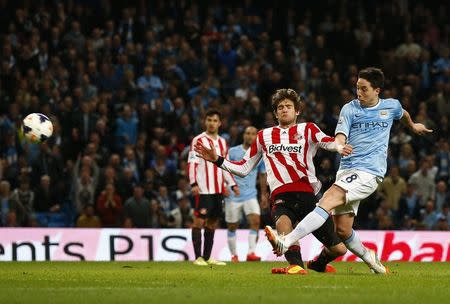 Manchester City's Nasri shoots on goal during their English Premier League soccer match against Sunderland at the Etihad stadium in Manchester