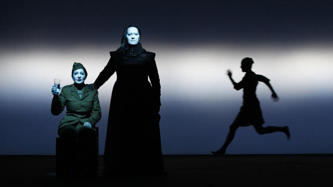 "In this 2011 photo released by Rio Film Festival, performance artist Marina Abramovic, left, performs during the making of the documentary film ""Bob Wilson's Life and Death of Marina Abramovic."" The film, by director Giada Colagrande, chronicles the staging of a play loosely based on Abramovic's traumatic childhood at the hands of an abusive and tyrannical mother. The film is playing at the 2012 Rio de Janeiro International Film Festival. (AP Photo/Lucie Jansch, Rio Film Festival)"