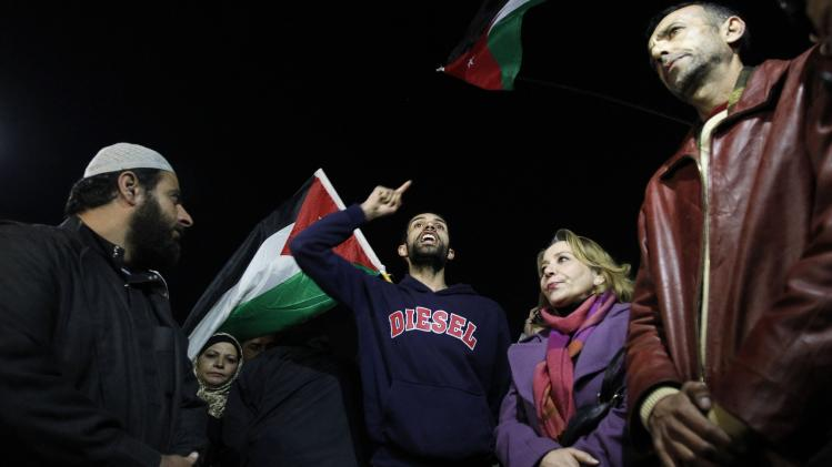 Jordanian protesters shout slogans against Israel during a protest near the Israeli embassy in Amman