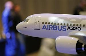A scale model of an A320 Airbus is displayed during the Airbus annual press conference in Colomiers, near Toulouse