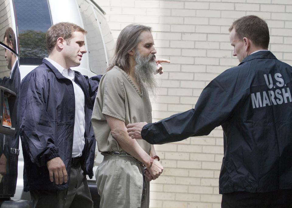 Brian David Mitchell is escorted into the Frank E. Moss Federal Courthouse Wednesday, May 25, 2011, in Salt Lake City. Nearly nine years after she was taken at knifepoint, raped and held captive, Elizabeth Smart is set to publicly confront her kidnapper for the first time,  when Mitchell is sentenced.  (AP Photo/Jim Urquhart)