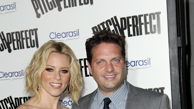 "FILE - This Sept. 24, 2012 file photo shows cast member and producer Elizabeth Banks, left, and her husband Max Handelman at the premiere of ""Pitch Perfect""  in Los Angeles. Banks announced on her website Wednesday, Nov. 14,  the arrival of her son Magnus Mitchell Handelman, who was born via gestational surrogate. The new baby joins her older son, 20-month-old Felix, who also was born via surrogate after the couple faced infertility issues.  (Photo by Matt Sayles/Invision/AP, file)"