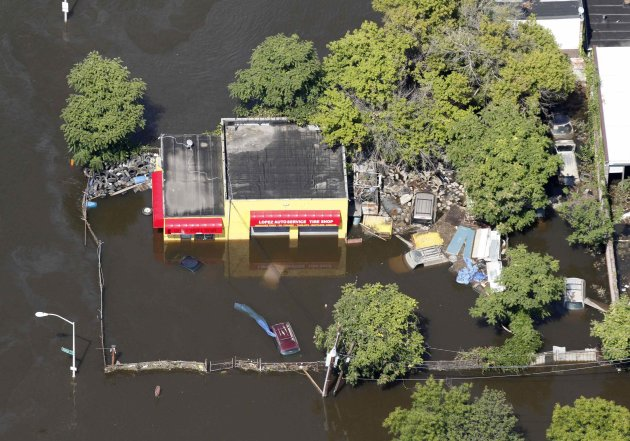 Flood waters from the Passaic River engulf a service station after Hurricane Irene in Paterson