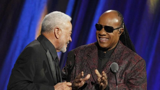 Musician Withers is inducted by Wonder during the 2015 Rock and Roll Hall of Fame Induction Ceremony in Cleveland