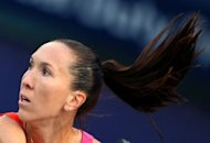 Second seed Jelena Jankovic, pictured here on February 24, has reached the semi-finals of the BMW Malaysian Open Saturday without having to pick up her racquet after Ayumi Morita pulled out injured, the second withdrawal in two days