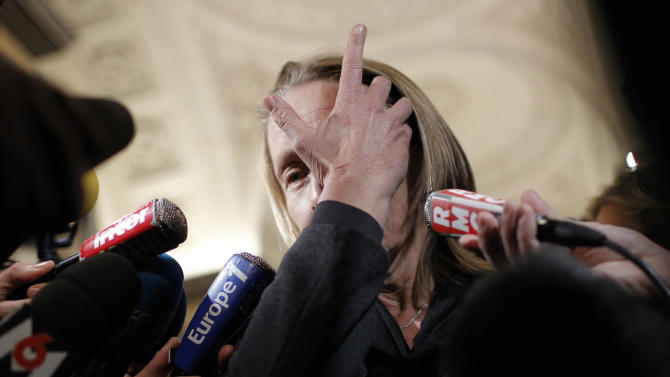 Former ranked tennis player Isabelle Demongeot reacts as she leaves the Lyon's courthouse, central France, at the end of the trial of Regis de Camaret, Friday, Nov. 23, 2012. The former tennis coach Regis de Camaret has been convicted and sentenced to eight years in prison for raping two young players attending the academy he used to run in Saint-Tropez. The case began with a book by Isabelle Demongeot, who described years of abuse. Several other women later came forward with accusations that the now-70-year-old Camaret raped or abused them when they trained in the 1980s and 1990s. The statute of limitations had run out for most of the accusers. (AP Photo/Laurent Cipriani)