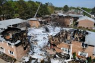 View of an apartment complex in the tourist resort of Virginia Beach, Virginia, where a US Navy F-18 jet fighter crashed after take-off April 6, 2012. Firefighters combed through the debris of the complex Saturday after the crashed that caused a massive inferno but injured only nine people