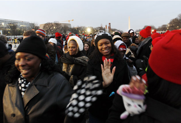President Barack Obama supporters arrive on the National Mall in Washington, Monday, Jan. 21,  2013, for President Barack Obama's ceremonial swearing-in ceremony during the 57th Presidential Inaugurat