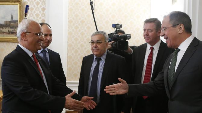 Russian Foreign Minister Lavrov approaches to shake hands with Palestinian chief negotiator Erekat during a meeting in Moscow