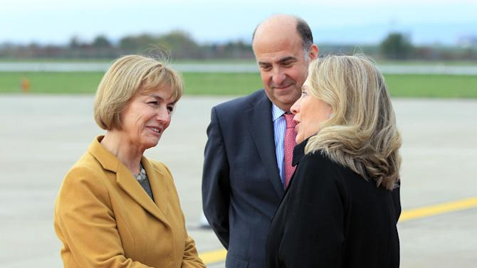 In this Wednesday, Oct. 31, 2012 file photo, US Secretary of State Hillary Clinton, right, is welcomed by Croatia's foreign minister Vesna Pusic, at Zagreb international airport, Croatia. Women in the Balkans are leading a political revolution. Historically given little say in the politics of the conservative region, they are increasingly taking top leadership posts, signaling that the traditional rules are changing as Balkan countries shake off their war pasts and move toward membership in the European Union.The person in the center is US ambassador to Croatia Kenneth H. Merten. (AP Photo/Damir Sencar, Pool, File)