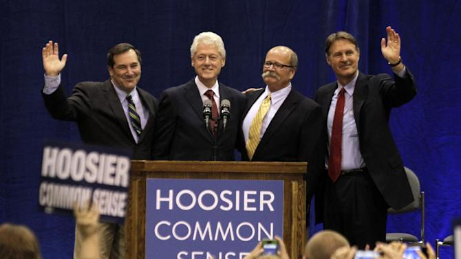 "Former President Bill Clinton, second from left, and former Indiana Sen. Evan Bayh, right, pose with Indiana Democratic Senate candidate Joe Donnelly, left, and Indiana Democratic gubernatorial candidate John Gregg, second from right, before Clinton spoke at ""Hoosier Common Sense"" rally in Indianapolis, Friday, Oct. 12, 2012.  (AP Photo/Michael Conroy)"