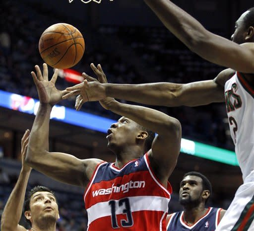 Ilyasova's tip-in lifts Bucks over Wizards 119-118