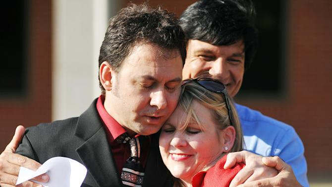 Paul Kevin Curtis, who had been in custody under suspicion of sending ricin-laced letters to President Barack Obama and others, left, hugs his attorney Christi McCoy during a news conference following his release Tuesday, April 23, 2013 in in Oxford, Miss. The charges were dismissed without prejudice, which means they could be re-instated if prosecutors so choose. (AP Photo/Oxford Eagle, Bruce Newman) MANDATORY CREDIT, MAGS OUT, NO SALES