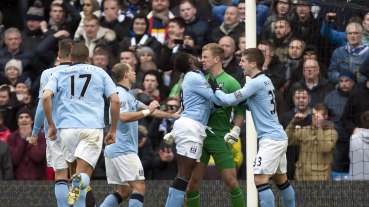 Manchester City's goalkeeper Joe Hart, centre right, celebrates with teammates after saving a penalty from Chelsea's Frank Lampard, during their English Premier League soccer match at The Etihad Stadium, Manchester, England, Sunday Feb. 24, 2013. (AP Photo/Jon Super)