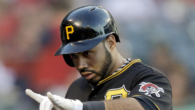Pittsburgh Pirates' Pedro Alvarez celebrates his home run against the Los Angeles Angels during the second inning of a baseball game in Anaheim, Calif., Friday, June 21, 2013. (AP Photo/Chris Carlson)
