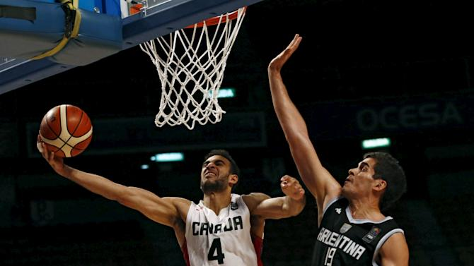Canada's Scrubb goes for the basket against Argentina's Mainoldi during their 2015 FIBA Americas Championship basketball game at the Sport Palace in Mexico City