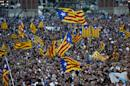 People wave Catalan flags at a pro-independence rally in Barcelona on September 25, 2015