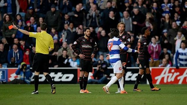Reading's Kaspars Gorkss (2nd right) is shown a red card against QPR by referee David Coote