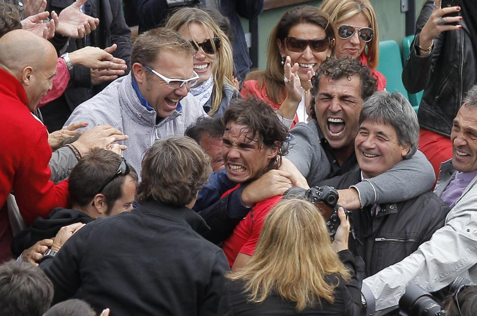 Spain's Rafael Nadal is congratulated by relatives after defeating Serbia's Novak Djokovic during their men's final match in the French Open tennis tournament at the Roland Garros stadium in Paris, Monday, June 11, 2012. Nadal passes Bjorn Borg as the all-time record-holder for French Open titles. (AP Photo/Michel Spingler)