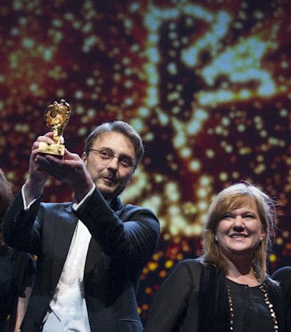Director Calin Peter Netzer holds the Golden Bear for his film Child&#39;s Pose alongside producer Ada Solomon at the closing ceremony at the 63rd edition of the Berlinale, International Film Festival in Berlin, Saturday, Feb. 16, 2013. (AP Photo/Gero Breloer)