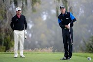 Jim Furyk of the United States watches his tee shot on the second hole as Graeme McDowell of Northern Ireland looks on during the final round of the 112th US Open at The Olympic Club in San Francisco, California