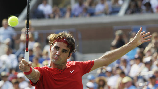 Roger Federer of Switzerland returns a shot to Marin Cilic of Croatia during the U.S. Open tennis tournament in New York, Saturday, Sept. 3, 2011. (AP Photo/Mike Groll)